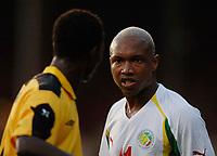 Picture: Henry Browne.<br /> Date: 17/08/2005.<br /> Senegal v Ghana International Friendly at Griffin Park, Brentford, London.<br /> El Hadj Diouf of Senegal gets angry with John Pantsil of Ghana after getting fouled.