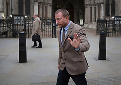 © Licensed to London News Pictures. 10/03/2016. London, UK. Guy Ritchie is seen leaving the High Court after attending a court hearing in connection with his son . Photo credit: Peter Macdiarmid/LNP