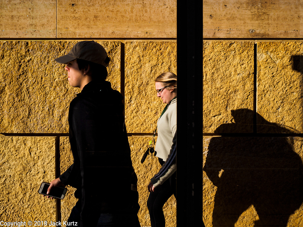 21 APRIL 2018 - MINNEAPOLIS, MN: People walk past a bus stop on 11th Street in downtown Minneapolis.    PHOTO BY JACK KURTZ