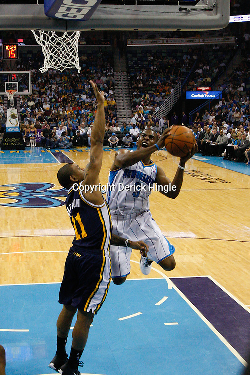 April 11, 2011; New Orleans, LA, USA; New Orleans Hornets point guard Chris Paul (3) shoots over Utah Jazz point guard Earl Watson (11) during the first half at the New Orleans Arena.  Mandatory Credit: Derick E. Hingle
