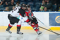 KELOWNA, CANADA - NOVEMBER 3:  Daniel Gibb #2 of the Prince George Cougars checks Cody Fowlie #18 of the Kelowna Rockets at the Kelowna Rockets on November 3, 2012 at Prospera Place in Kelowna, British Columbia, Canada (Photo by Marissa Baecker/Shoot the Breeze) *** Local Caption ***