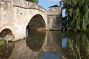 Historic stone bridge crossing River Thames at Lechlade on Thames, Gloucestershire, England, UK