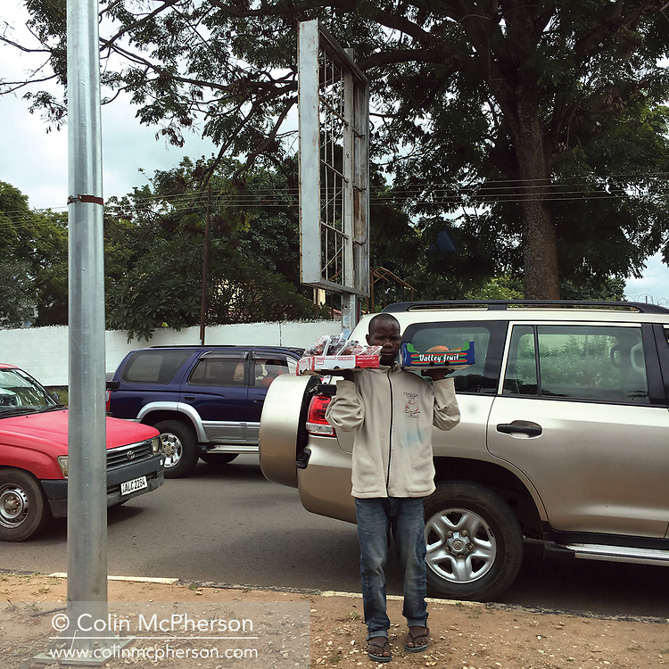 'Africa Drive-by' a photo book published in 2017. <br /> <br /> The images were captured from the back of police motorcades and security vehicles in eight southern African countries in spring and summer, 2017.<br /> <br /> Photo shows: Zambia.<br /> <br /> It was self-published the same year in an edition of 250.