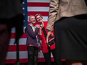 "20 OCTOBER 2019 - INDIANOLA, IOWA: US Senator ELIZABETH WARREN (D-MA), right, poses for a ""selfie"" with a girl after her campaign speech at Simpson College in Indianola, IA, Sunday. Sen. Warren is campaigning to be the Democratic nominee for the US presidency in Iowa this week. Iowa traditionally hosts the the first selection event of the presidential election cycle. The Iowa Caucuses will be on Feb. 3, 2020.                 PHOTO BY JACK KURTZ"
