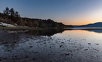 Sunset and low tide at Coles Bay Regional Park in North Saanich, on the Saanich Pennisula of Vancouver Island, is a quiet and pristine place with expansive ocean views.