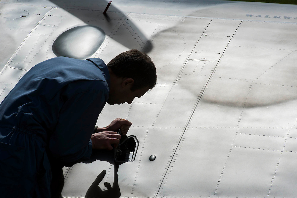 Martin Overall, one of the engineers who refurbished it, prepares to start the engine - Vickers Supermarine Spitfire Mk.1A – P9374/G-MK1A – it was in action in the Battle of France in 1940 and recovered from the sands of a Calais beach in 1980. It was restored by the Aircraft Restoration Company, and will fly in the VE Day Anniversary Air Show (Saturday 23 and Sunday 24 May) at IWM Duxford. Christie's is to offer the Spitfire P9374 for auction in The Exceptional Sale on 9 July 2015.  The estimate for the sale is  £1,500,000-2,500,000. With the plane are John Romain, Pilot and Chief Engineer at the Aircraft Restoration Company and Ken Wilkinson, a veteran who flew Spitfires in the Second World War. IWM Duxford, Cambridge