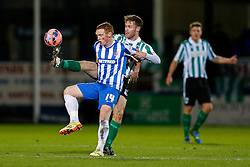 Michael Woods of Hartlepool United and Stephen Turnbull of Blyth Spartans compete for the ball - Photo mandatory by-line: Rogan Thomson/JMP - 07966 386802 - 05/12/2014 - SPORT - FOOTBALL - Hartlepool, England - Victoria Park - Hartlepool United v Blyth Spartans - FA Cup Second Round Proper.