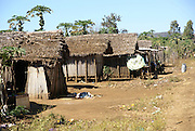 Madagascar, Ankarana Special Reserve. A row of thatch huts in a village