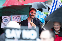 © Licensed to London News Pictures . 16/09/2018. Manchester, UK. Labour MP AFZAL KHAN at the back of the crowd . Thousands of people including the UK's Chief Rabbi and several Members of Parliament attend a demonstration against rising anti-Semitism in British politics and society , at Cathedral Gardens in Manchester City Centre . Photo credit : Joel Goodman/LNP