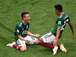 June 17, 2018 - Moscow, Russia - Mexico's HIRVING LOZANO (L) celebrates scoring a goal against Germany during a Group F match at the 2018 FIFA World Cup. Mexico won 1:0. (Credit Image: © Wang Yuguo/Xinhua via ZUMA Wire)
