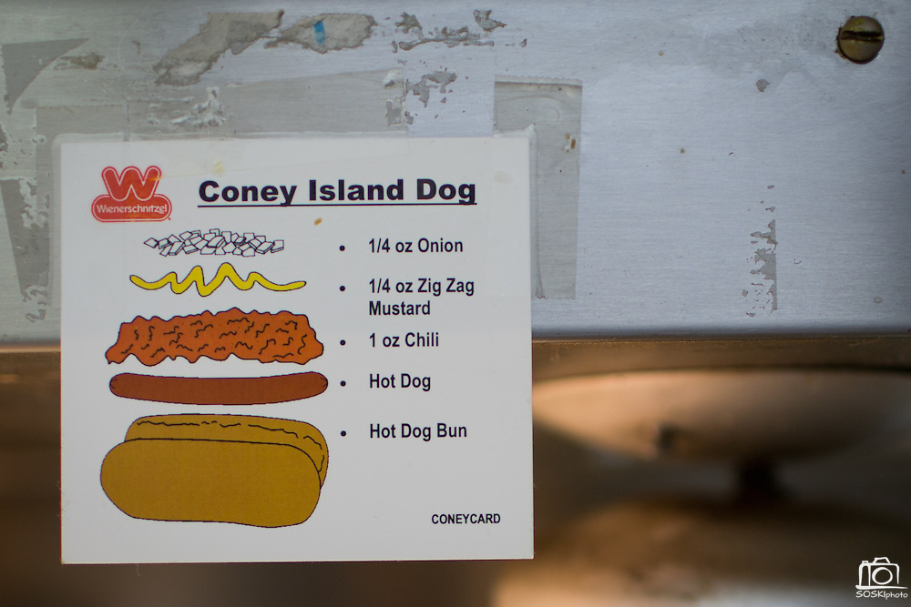 A sign in the kitchen shows how to prepare a Coney Island Dog at Wienerschnitzel in Milpitas, California, on February 22, 2014.  The S. Park Victoria Dr. location is closing its doors after 17 years of service after the the stores lease was not renewed. (Stan Olszewski/SOSKIphoto)