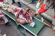A shiite muslim man receives medical attention after fainting due to excessive blood loss during the Day of Ashura in Nabatieh, Lebanon.