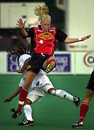 Philadelphia Charge midfielder Rakel Karvelsson (4), falls on top of Carolina Courage defender Staci Wilson (27), in the first half, Monday, Aug. 6, 2001, in Villanova, Pa. The Charge defeated the Courage 5-1. (William Thomas Cain/photodx.com)
