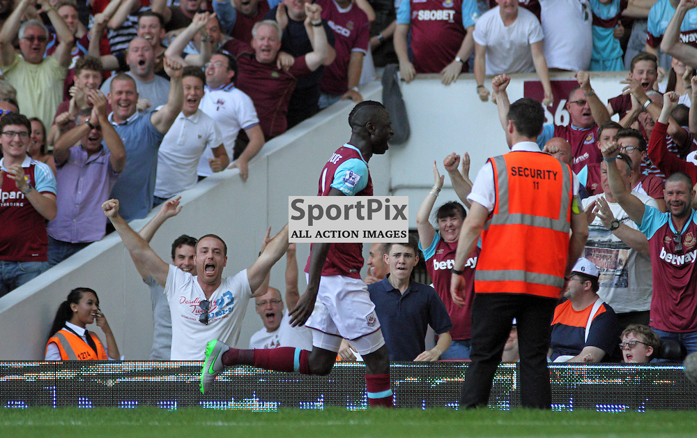 Cheikhou Kouyate celebrates with the west ham fans  During West Ham United vs Bournemouth FC on Saturday the 22nd August 2015