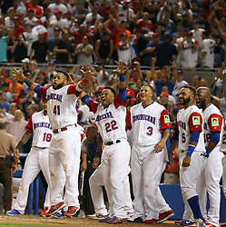 March 11, 2017 - Miami, FL, USA - Dominican Republic players wait to congratulate Starling Marte after his solo home run during the eighth inning against the United States in a World Baseball Classic first round Pool C game at Marlins Park in Miami on Saturday, March 11, 2017. The Dominican Republic won, 7-5. (Credit Image: © David Santiago/TNS via ZUMA Wire)