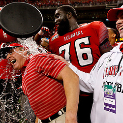December 22, 2012; New Orleans, LA, USA; Louisiana-Lafayette Ragin Cajuns head coach Mark Hudspeth is dunked with a cooler by his players following a win over the East Carolina Pirates in the New Orleans Bowl at the Mercedes-Benz Superdome. UL-Lafayette defeated East Carolina 43-34. Mandatory Credit: Derick E. Hingle-USA TODAY Sports