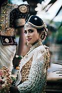 A Sri Lankan couple take wedding photos in traditional dress, early morning in downtown Kandy, Sri Lanka, Asia