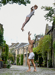 Pictured: Dancers Nikki Rummer and JD Brousse get in some practice before their next show.<br /> <br /> Acclaimed circus duo Nikki & JD practice in the picturesque and aptly named Circus Lane. These talented performers use breathtaking hand-to-hand and dance skills to tell the tale of an impossible choice: how can we be honest with ourselves without hurting those we love? Part of the British Council Edinburgh Showcase 2019, Knot is a finely crafted journey through the struggles of commitment, exploring the absurdity, mundanity and joy of a very modern affair.<br /> <br /> © Dave Johnston / EEm