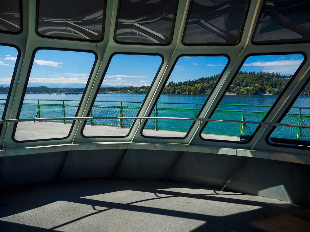 United States, Washington, Seattle, view of Bainbridge Island through ferry windows.