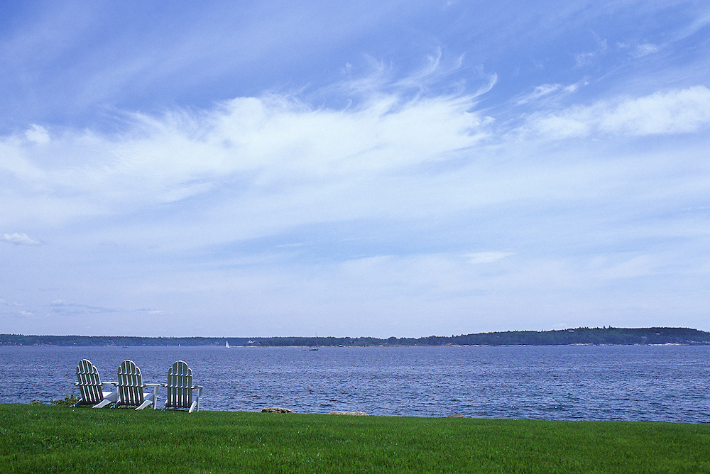 Three chairs overlooking Maine bay