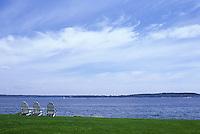 Three chairs overlooking Maine bay