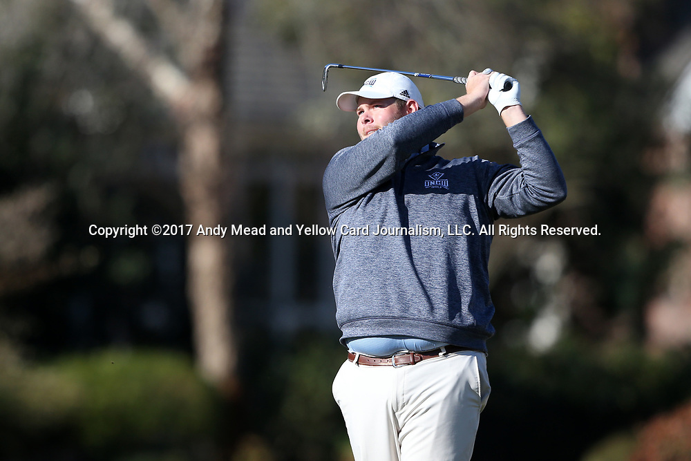 WILMINGTON, NC - MARCH 19: UNC Wilmington's Austin Inman tees off the Ocean Course fourth hole. The first round of the 2017 Seahawk Intercollegiate Men's Golf Tournament was held on March 19, 2017, at the Country Club of Landover Nicklaus Course in Wilmington, NC.