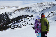 SHOT 2/14/11 12:47:26 PM - Loveland Ski Area in Colorado hosted the 20th Annual Marry Me & Ski Free Mountaintop Matrimony on Valentine's Day Monday, February 14th. The mass wedding ceremony was held at noon at 12,050 feet outside of the Ptarmigan Roost Cabin at Loveland. More than 75 couples were pre-registered to get married or renew their vows high on The Continental Divide in this yearly Loveland tradition.  Following the ceremony couples were invited to a casual reception complete with a champagne toast, wedding cake and music.  (Photo by Marc Piscotty / © 2010)