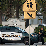 THURSDAY, FEBRUARY 15- 2018---PARKLAND, FLORIDA--<br /> Broward Sheriff Office deputy in front of the Marjory Stoneman Douglass High School one day after a mass shooting with 17 casualties.<br /> (Photo by Angel Valentin/FREELANCE)