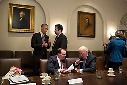 President Barack Obama talks with Rep. Raul Labrador, R-Idaho, as Vice President Joe Biden talks with Sen. Mike Lee, R-Utah, following a meeting with bipartisan Members of Congress to discuss criminal justice reform, in the Cabinet Room of the White House, Feb. 24, 2015. (Official White House Photo by Pete Souza)<br /> <br /> This official White House photograph is being made available only for publication by news organizations and/or for personal use printing by the subject(s) of the photograph. The photograph may not be manipulated in any way and may not be used in commercial or political materials, advertisements, emails, products, promotions that in any way suggests approval or endorsement of the President, the First Family, or the White House.