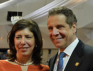 Seaford, New York, USA. 3rd June 2014. Acting District Attorney of Nassau County MADELINE SINGAS and New York State Governor ANDREW CUOMO, pose for a photograh at end of Press Conference supporting extension of the NY Property Tax Cap. At the bi-partisan event at Knights of Columbus Hall, over a hundred area residents and officials, and the governor, urged extending the property tax cap before the state legislative session ends on June 17. The NY Property Tax Cap is set to expire June 2016, but is legally linked to NYC rent-control regulations set to expire this month.