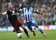 Kazenga LuaLua, Brighton midfielder takes on Norwich City's defender Steven Whittaker during the Sky Bet Championship match between Brighton and Hove Albion and Norwich City at the American Express Community Stadium, Brighton and Hove, England on 3 April 2015.