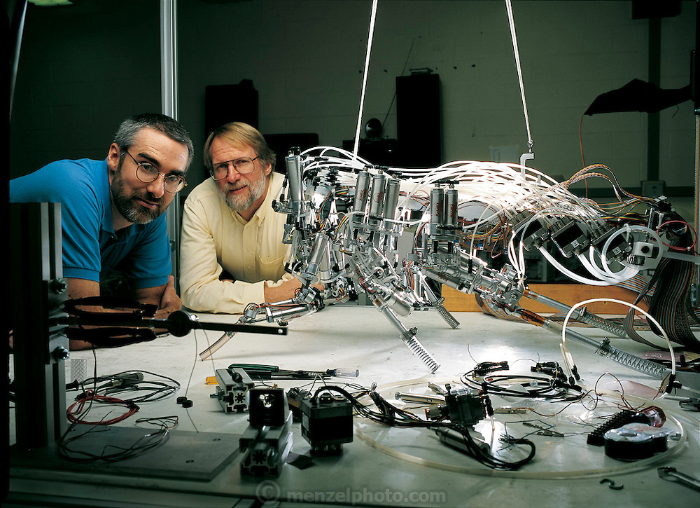 The product of a long quest, Robot III, an artificial cockroach built by mechanical engineer Roger Quinn (in blue shirt) and biologist Roy Ritzmann at Case Western Reserve University in Cleveland, OH, required seven years to construct. (Quinn directs the Biorobotics Lab at the university.) From the book Robo sapiens: Evolution of a New Species, page 102-103.