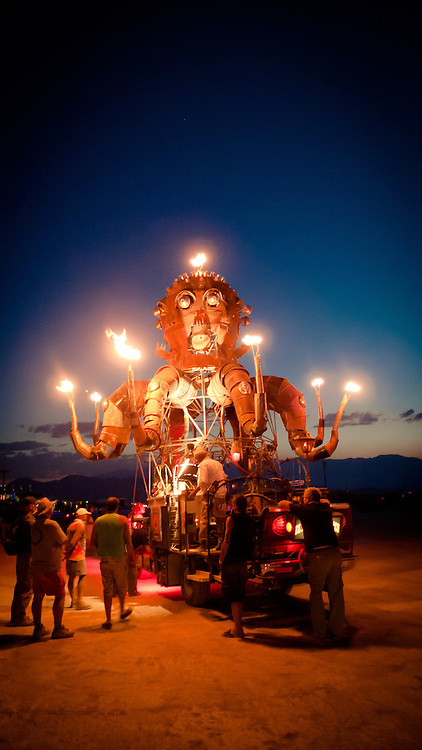 A steampunk octupus art car named El Pulpo Mecanico , spews fire for onlookers at Burning Man Festival