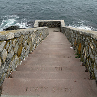 The Forty Steps on the Cliff Walk, Newport, Rhode Island, USA. The steps go down approximately two-thirds of the way to the waters edge affording spectacular views of waves breakling against the cliff.