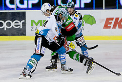 Miha Verlic (HDD Tilia Olimpija, #91) vs Fabian Scholz (EHC Liwest Linz, #44) during ice-hockey match between HDD Tilia Olimpija and EHC Liwest Black Wings Linz in 51st Round of EBEL league, on Februar 5, 2012 at Hala Tivoli, Ljubljana, Slovenia. (Photo By Matic Klansek Velej / Sportida)