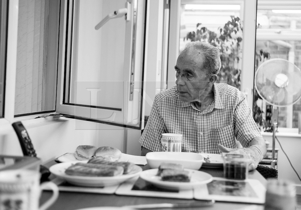 © Licensed to London News Pictures. 09/04/2014<br /> These photographs have been converted to black and white<br /> <br /> Durham, United Kingdom<br /> <br /> Parkinson's Disease sufferer David Forsyth from Brandon, County Durham looks through a window into another room as he hallucinates that he is seeing someone in the room. <br /> <br /> The hallucinations are a result of some of the medications that he needs to take to try and keep some of the severe symptoms of the illness under control.<br /> <br /> Parkinson's is a long-term neurological condition that affects the way the brain co-ordinates body movements including walking, talking and writing and affects both men and women.<br /> <br /> Photo credit : Ian Forsyth/LNP