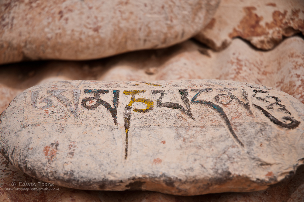Mantras are carved into rocks and stacked to create prayer walls.