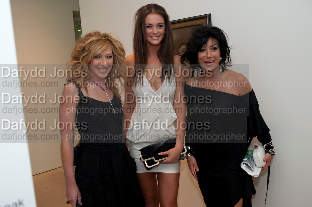 KELLY HOPPEN; LAUREN BUDD; NANCY DELL D'OLIO, Hear the World Ambassadors Ð An Exhibition of Photography by Bryan Adams , The Saatchi Gallery. Sloane sq. London. 21 July 2009. Hear the World - an initiative by Phonak, aims to raise international awareness about hearing and hearing loss<br /> KELLY HOPPEN; LAUREN BUDD; NANCY DELL D'OLIO, Hear the World Ambassadors ? An Exhibition of Photography by Bryan Adams , The Saatchi Gallery. Sloane sq. London. 21 July 2009. Hear the World - an initiative by Phonak, aims to raise international awareness about hearing and hearing loss