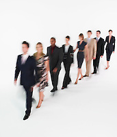 Line of businesspeople walking blurred effect
