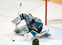 April 22, 2010; San Jose, CA, USA; San Jose Sharks goaltender Evgeni Nabokov (20) makes a save against the Colorado Avalanche during the second period of game five in the first round of the 2010 Stanley Cup Playoffs at HP Pavilion.  San Jose defeated Colorado 5-0. Mandatory Credit: Jason O. Watson / US PRESSWIRE