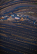 Aerial view of rail yard for coal trains at the port of Norfolk, Virginia where the coal is loaded onto ships. A turntable can be seen a center for reversing the direction of the locomotives..