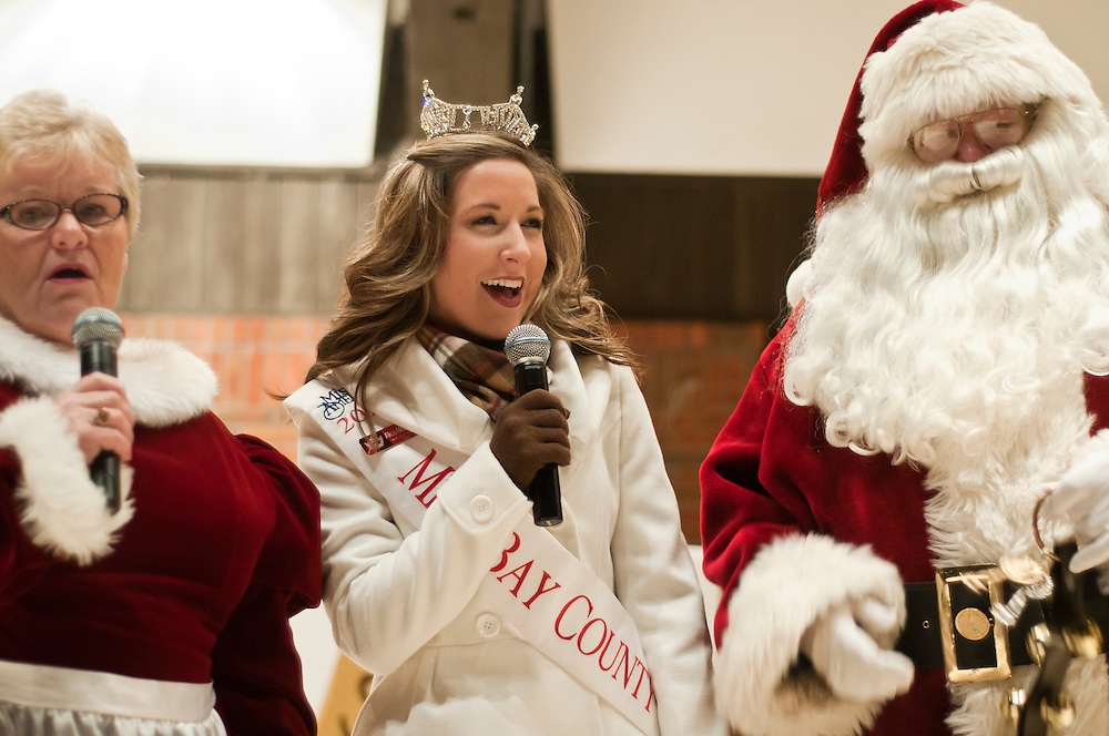 Lathan Goumas | The Bay City Times..Miss Bay County Alicia McInerney sings 'Jingle Bells' with Santa and Mrs. Claus at Wenonah Park in Bay City, MI. on Friday November 25, 2011. McInerny was a surprise guest at the event.