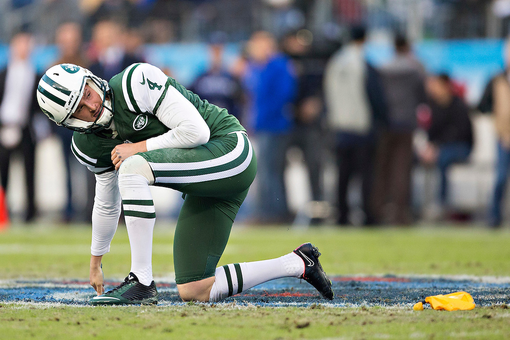 NASHVILLE, TN - DECEMBER 14:   Ryan Quigley #4 of the New York Jets gets up off the ground after being bumped punting the ball in the second quarter of a game against the Tennessee Titans at LP Field on December 14, 2014 in Nashville, Tennessee.  The Jets defeated the Titans 16-11.  (Photo by Wesley Hitt/Getty Images) *** Local Caption *** Ryan Quigley