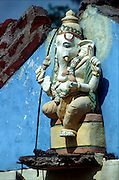 Sri Lanka..White Ganesh on top of a small Kovil Probably Hill Country.
