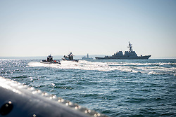 BLACK SEA (Aug. 13, 2018) Bulgarian Navy patrol boats engage in a swarming exercise with the Arleigh Burke-class guided-missile destroyer USS Carney (DDG 64) in the Black Sea. U.S. 6th Fleet, headquartered in Naples, Italy, conducts the full spectrum of joint and naval operations, often in concert with allied and interagency partners, in order to advance U.S. national interests, security and stability in Europe and Africa. (U.S. Navy photo by Mass Communication Specialist 2nd Class Jonathan Nelson/Released)180813-N-WO404-321