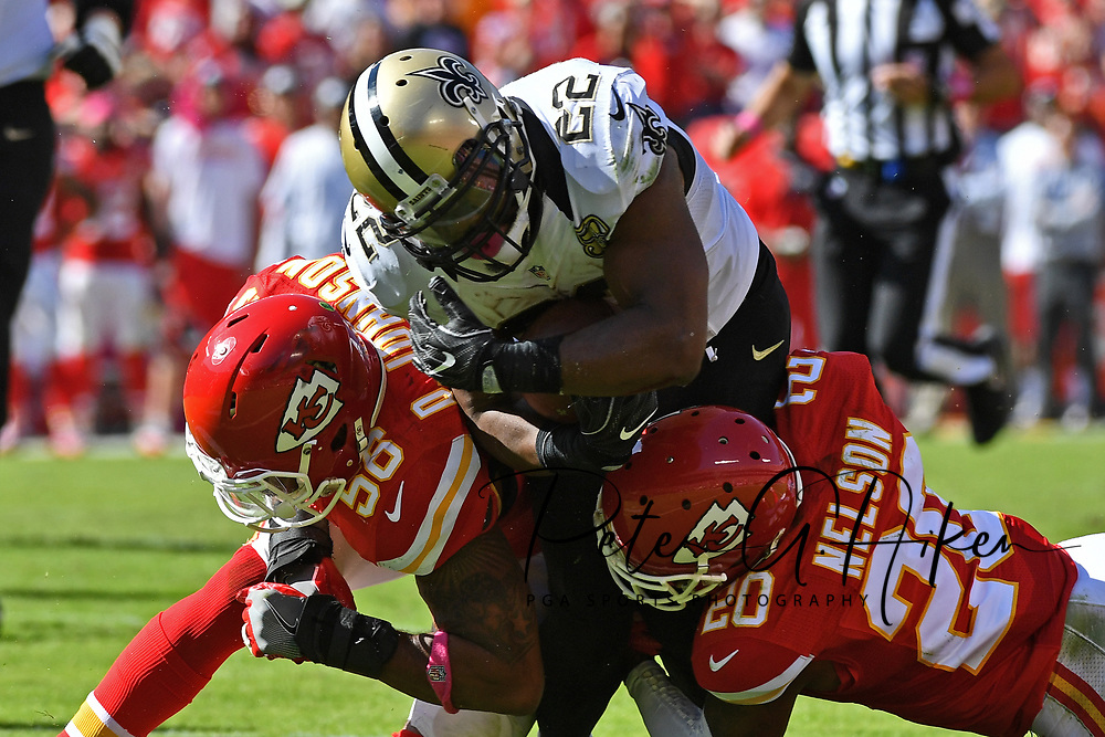 KANSAS CITY, MO - OCTOBER 23:  Running back Mark Ingram #22 of the New Orleans Saints gets tackled by defenders Derrick Johnson #56 and Steven Nelson #20 of the Kansas City Chiefs during the second half on October 23, 2016 at Arrowhead Stadium in Kansas City, Missouri.  (Photo by Peter Aiken/Getty Images) *** Local Caption *** Mark Ingram;derrick Johnson;Steven Nelson