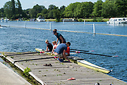 """Henley on Thames, United Kingdom, 21st June 2018, Thursday, Training day before the start of  """"Henley Women's Regatta"""",  Thursday,  view, Running repairs four, moored while the coach, adjusts the seat,  Henley Reach, River Thames, England, © Peter SPURRIER/Alamy Live News"""