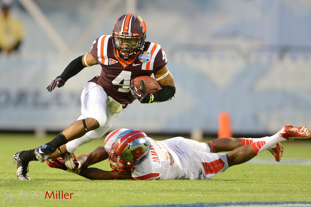 Virginia Tech Hokies running back J.C. Coleman (4) runs upfield during the Russell Athletic Bowl against Rutgers Scarlet Knights on Dec 28, 2012 in Orlando, Florida. ...©2012 Scott A. Miller..