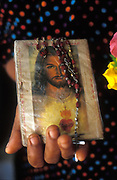 St. James Church, Kayts island, Jaffna Peninsula. Woman holds prayer book and rosary.