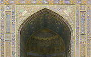 North iwan coverd in polychromatic tiles. Imam Mosque (Masjed-e Imam), is a mosque in Isfahan, Iran standing in south side of Naghsh-i Jahan Square. Built 1611 - 1629. Architect: Shaykh Bahai